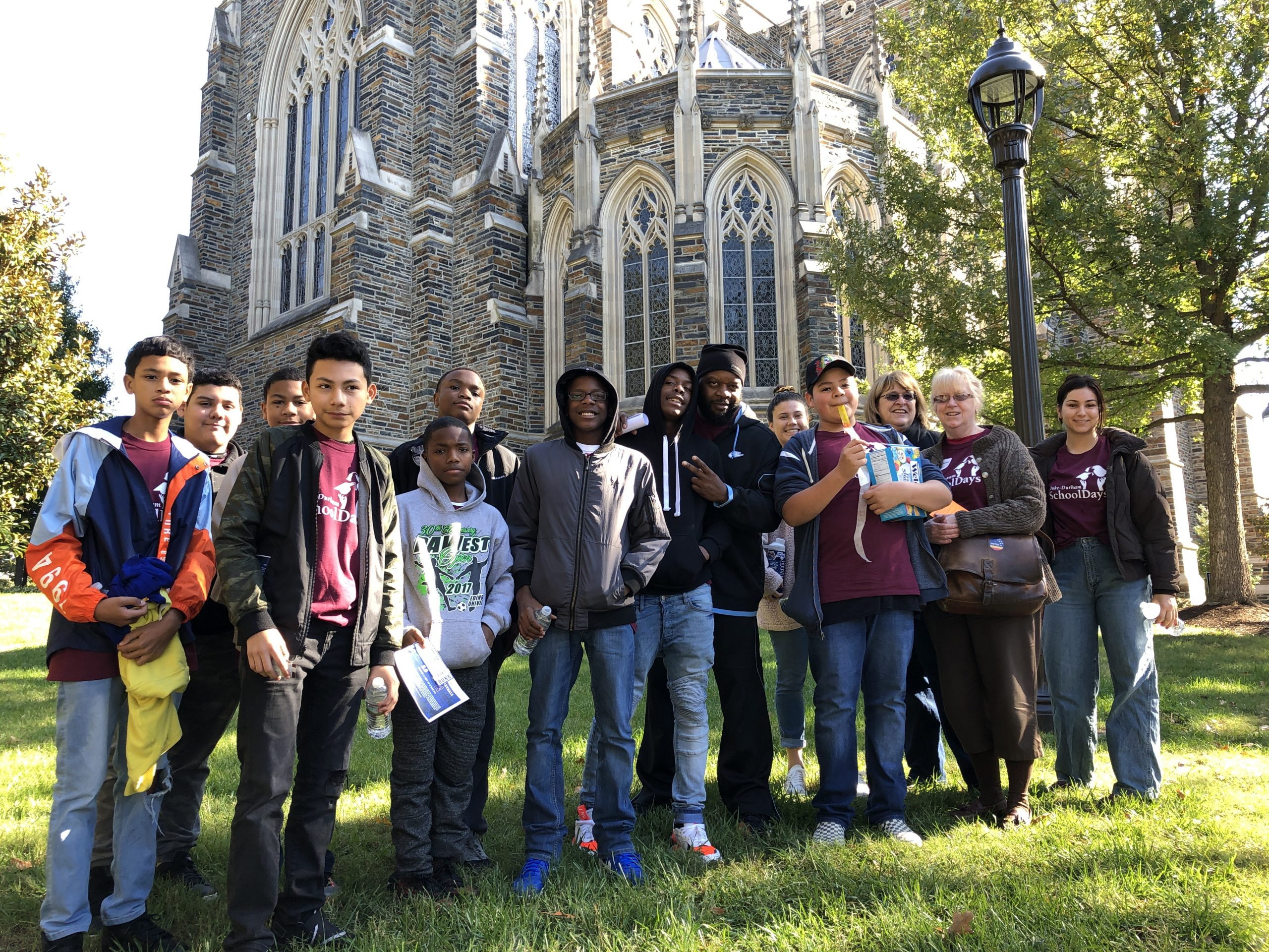 A group of middle school students pose in front of Duke chapel