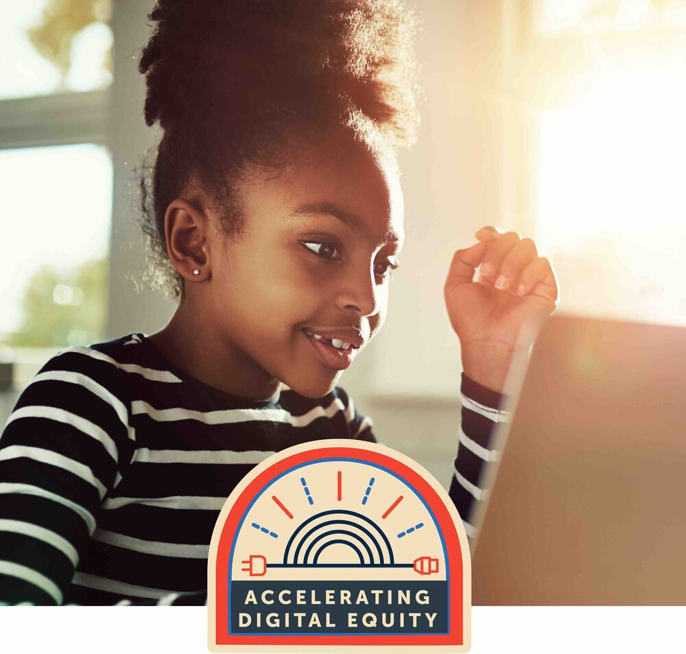 A girl at a computer with Accelerating Digital Equity logo