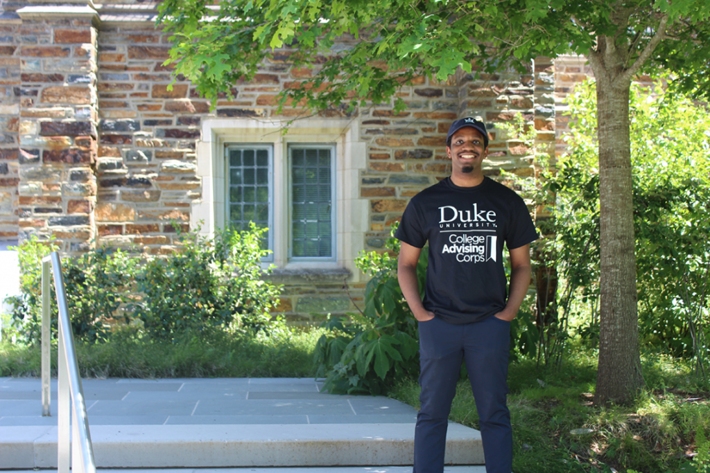 college advising corp staff Desmond Gatling in front of a Duke building