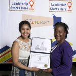 Civic engagement staff hand a student an award at the student leadership awards